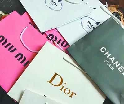 曲光包装解决方案-做纸袋一般都用多少克的纸张